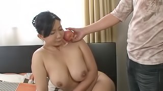 Mature Asian woman with big natural tits enjoying a hardcore fuck on her bed