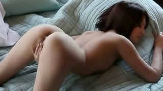 A Ravishing Redhead Gazes At Us While She Plays With Herself